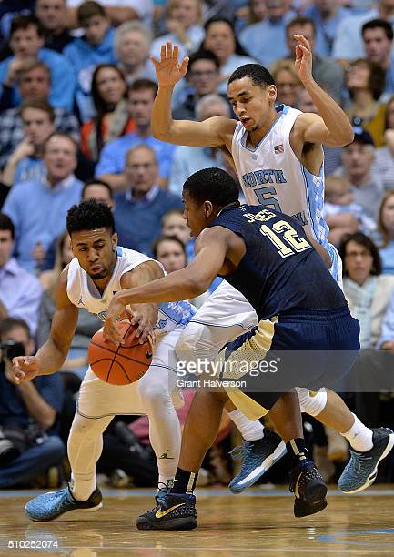 Joel Berry II of the North Carolina Tar Heels knocks the ball away from Chris Jones of the Pittsburgh Panthers during their game at the Dean Smith...