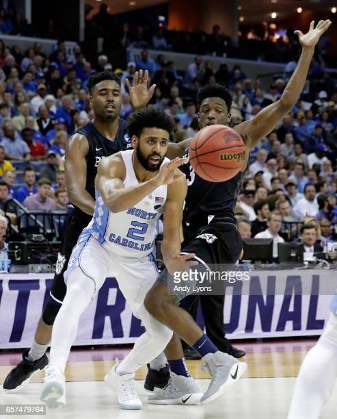 Joel Berry II of the North Carolina Tar Heels passes against Kamar Baldwin of the Butler Bulldogs in the second half during the 2017 NCAA Men's...