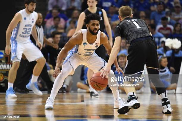 Joel Berry II of the University of North Carolina defends Tyler Lewis of Butler University during the 2017 NCAA Men's Basketball Tournament at...