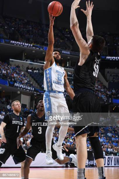 Joel Berry II of the University of North Carolina shoots against Nate Fowler of Butler University during the 2017 NCAA Men's Basketball Tournament at...