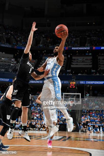 Joel Berry II of the University of North Carolina shoots against Tyler Lewis of Butler University during the 2017 NCAA Men's Basketball Tournament at...