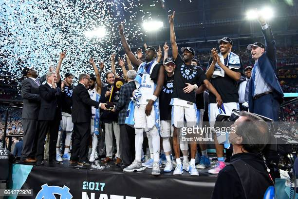 Joel Berry II Theo Pinson of the North Carolina Tar Heels and team mates celebrate after winning during the 2017 NCAA Men's Final Four National...