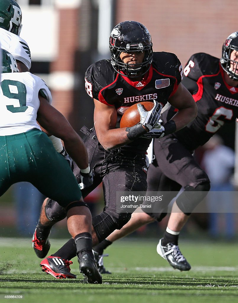 Joel Bouagnon #28 of the Northern Illinois Huskies rushes against the Eastern Michigan Eagles at Brigham Field on October 26, 2013 in DeKalb, Illinois.