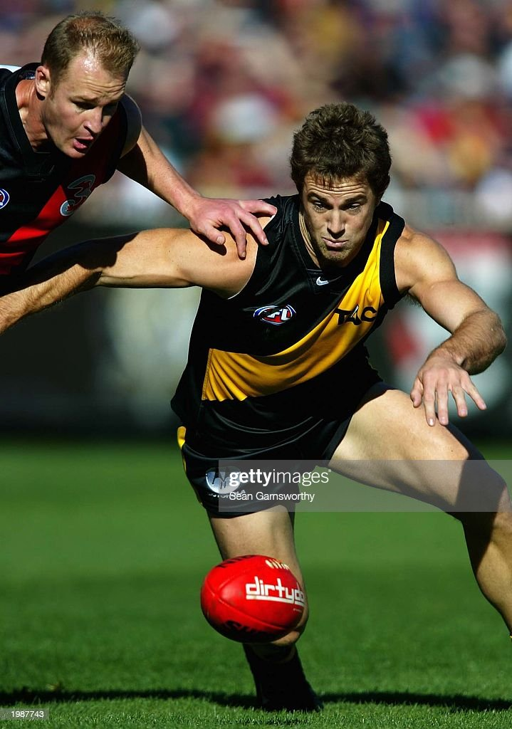 Joel Bowden of Richmond and Sean Wellman of Essendon in action during the AFL Round seven Premiership Cup match between the Richmond Tigers and the...