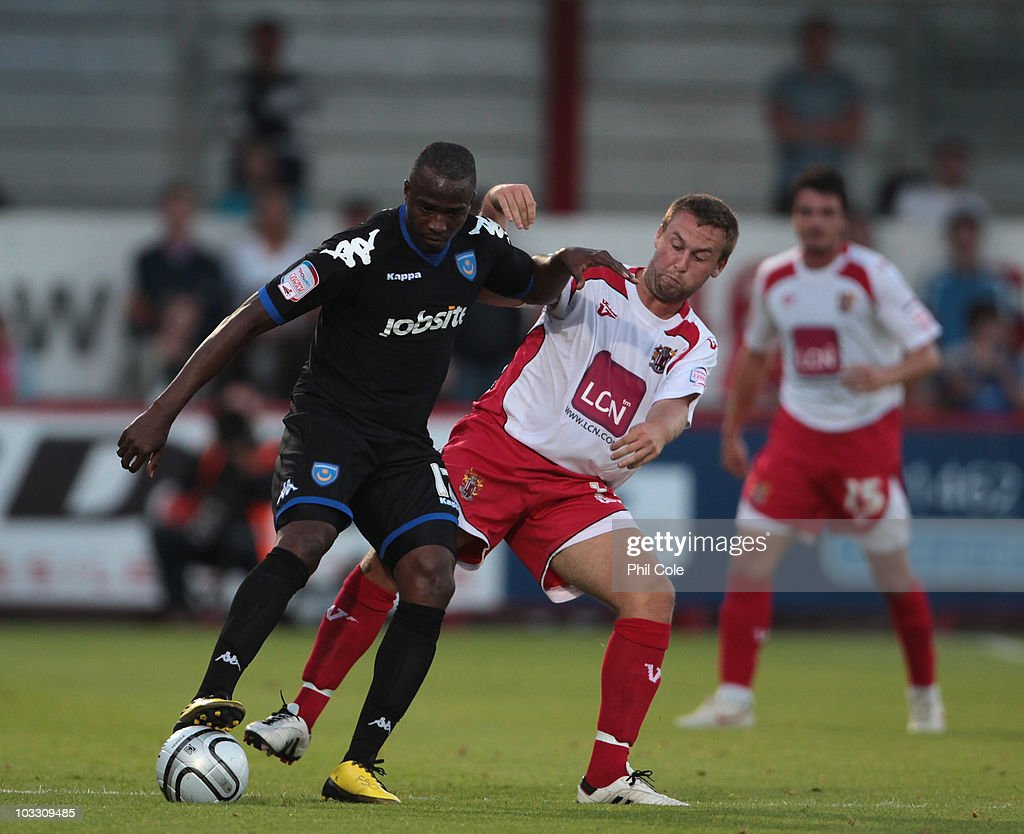 Joel Byrom of Stevenage tackles Jon Utaka of Portsmouth during the first- round of the Carling Cup between Stevenage Borough and Portsmouth at the Lamex Stadium on August 9, 2010 in Stevenage, England.