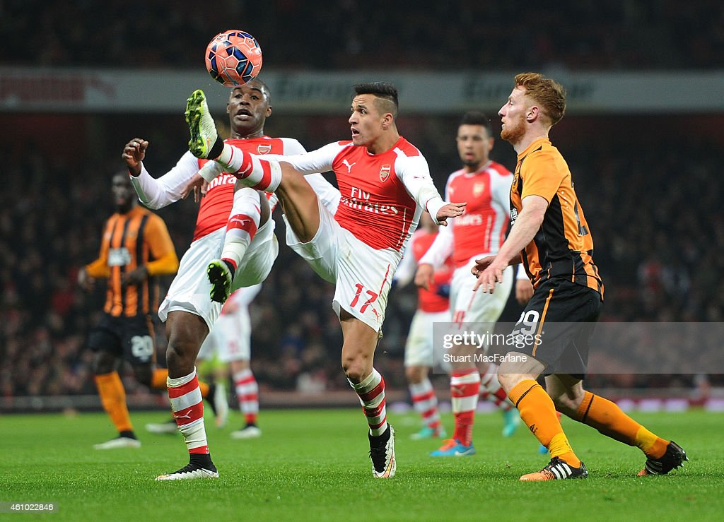 Joel Campbell and Alexis Sanchez of Arsenal take on Stephen Quinn of Hull during the FA Cup Third Round match between Arsenal and Hull City at Emirates Stadium on January 4, 2015 in London, England.