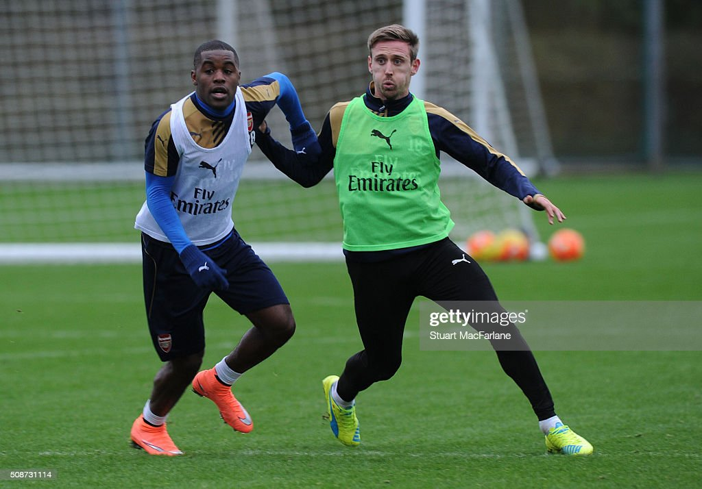 <a gi-track='captionPersonalityLinkClicked' href=/galleries/search?phrase=Joel+Campbell&family=editorial&specificpeople=5832048 ng-click='$event.stopPropagation()'>Joel Campbell</a> and <a gi-track='captionPersonalityLinkClicked' href=/galleries/search?phrase=Nacho+Monreal&family=editorial&specificpeople=4078049 ng-click='$event.stopPropagation()'>Nacho Monreal</a> of Arsenal during a training session at London Colney on February 6, 2016 in St Albans, England.