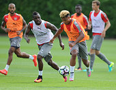 Joel Campbell and Serge Gnabry of Arsenal during a training session at London Colney on July 21 2016 in St Albans England