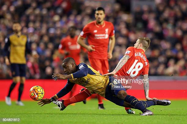 Joel Campbell of Arsenal and Alberto Moreno of Liverpool compete for the ball during the Barclays Premier League match between Liverpool and Arsenal...