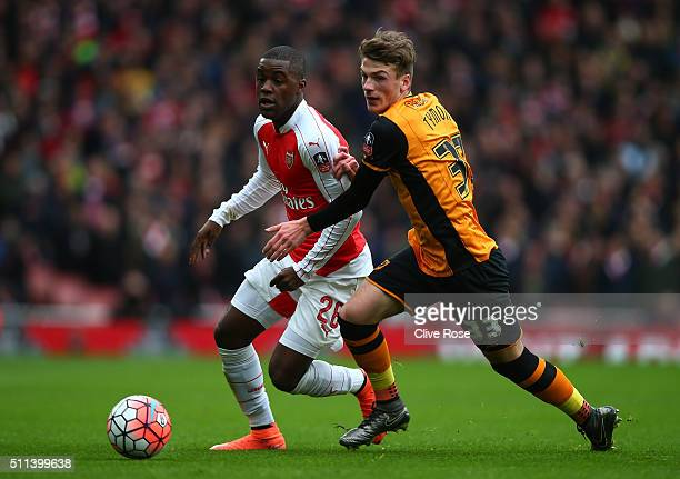 Joel Campbell of Arsenal and Josh Tymon of Hull City compete for the ball during the Emirates FA Cup fifth round match between Arsenal and Hull City...