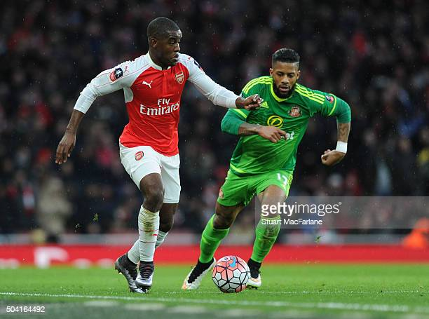 Joel Campbell of Arsenal breaks past Jermain Lens of Sunderland during the Emirates FA Cup Third Round match between Arsenal and Sunderland at...