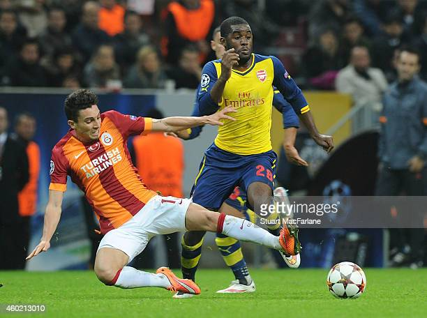 Joel Campbell of Arsenal challenged by Alex Telles of Galatasaray during the UEFA Champions League match between Galatasaray and Arsenal at the Turk...