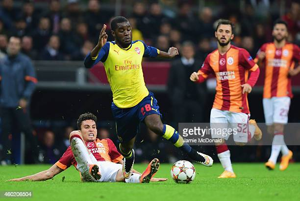 Joel Campbell of Arsenal is tackled by Alex Telles of Galatasaray during the UEFA Champions League Group D match between Galatasaray AS and Arsenal...