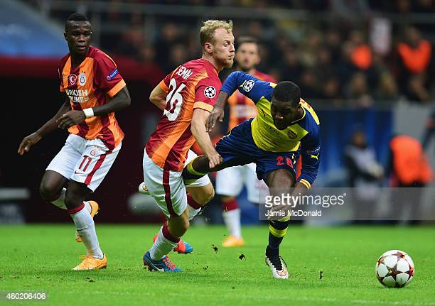 Joel Campbell of Arsenal takes on Bruma and Semih Kaya of Galatasaray during the UEFA Champions League Group D match between Galatasaray AS and...