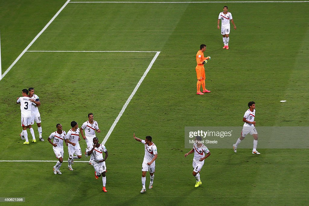 Joel Campbell of Costa Rica (seen with a ball under his shirt) celebrates with his team-mates after scoring his sides first goal at Castelao on June 14, 2014 in Fortaleza, Brazil.