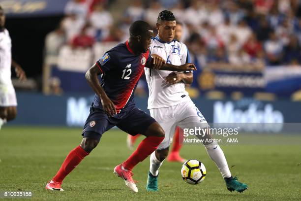 Joel Campbell of Costa Rica competes with Bryan Acosta of Honduras during the 2017 CONCACAF Gold Cup Group A match between Honduras and Costa Rica at...