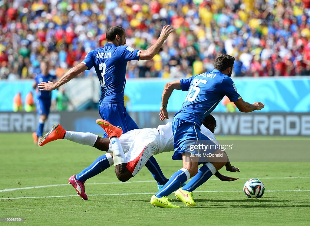 <a gi-track='captionPersonalityLinkClicked' href=/galleries/search?phrase=Joel+Campbell&family=editorial&specificpeople=5832048 ng-click='$event.stopPropagation()'>Joel Campbell</a> of Costa Rica falls after a challenge by <a gi-track='captionPersonalityLinkClicked' href=/galleries/search?phrase=Giorgio+Chiellini&family=editorial&specificpeople=605793 ng-click='$event.stopPropagation()'>Giorgio Chiellini</a> (L) and Andrea Barzagli of Italy during the 2014 FIFA World Cup Brazil Group D match between Italy and Costa Rica at Arena Pernambuco on June 20, 2014 in Recife, Brazil.
