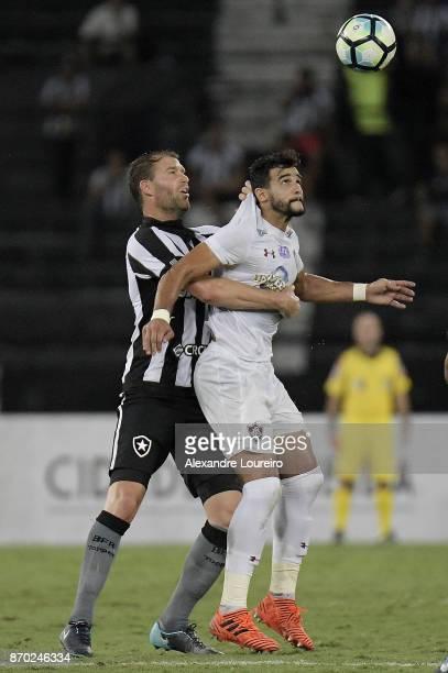 Joel Carli of Botafogo battles for the ball with Henrique Dourado of Fluminense during the match between Botafogo and Fluminense as part of...