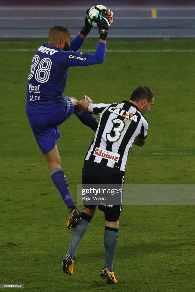 Joel Carli (R) of Botafogo struggles for the ball with goalkeeper Muralha of Flamengo during a match between Botafogo and Flamengo as part of Copa do Brasil Semifinals 2017 at Nilton Santos Olympic Stadium on August 16, 2017 in Rio de Janeiro, Brazil.