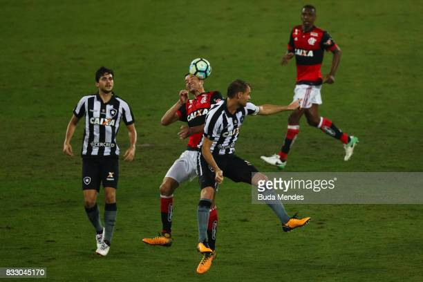 Joel Carli of Botafogo struggles for the ball with Rever of Flamengo during a match between Botafogo and Flamengo as part of Copa do Brasil...