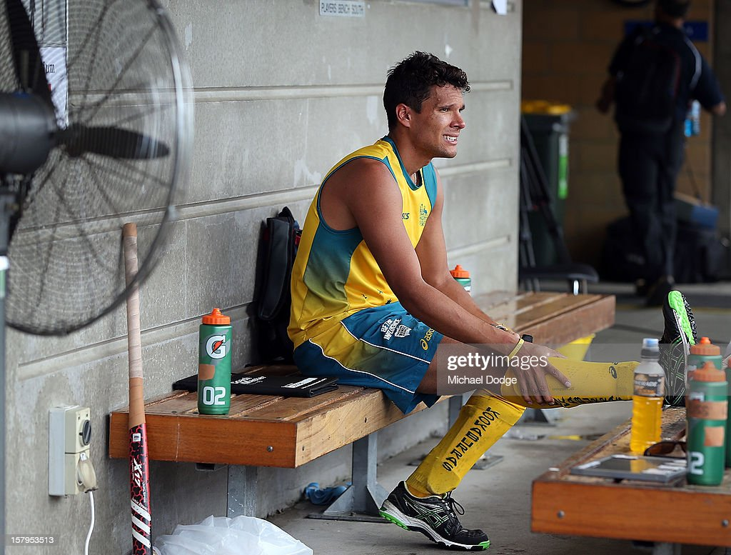 Joel Carroll of Australia cools down in front of a fan after the match between Australia and India during day five of the 2012 Champions Trophy at the State Netball and Hockey Centre on December 8, 2012 in Melbourne, Australia.