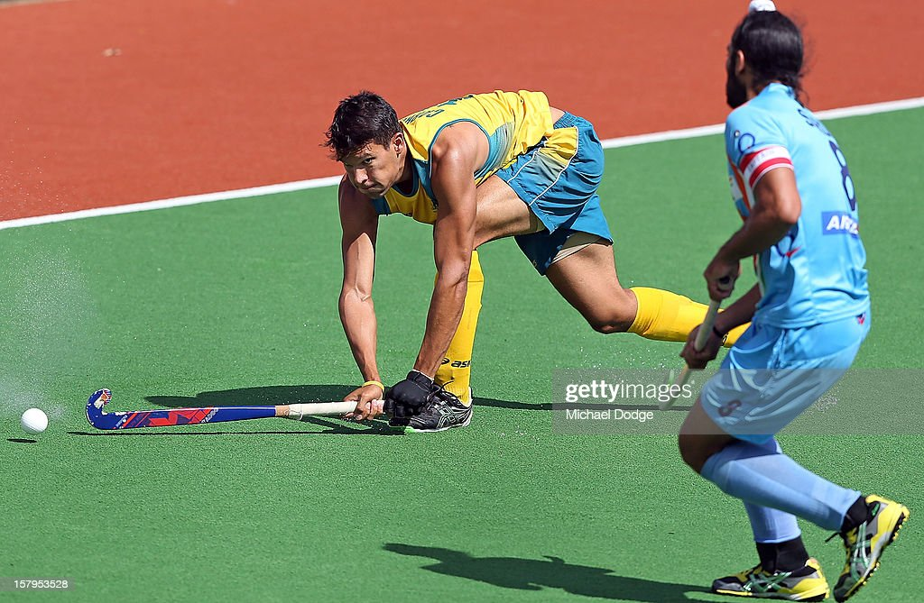 Joel Carroll of Australia hits the ball during the match between Australia and India during day five of the 2012 Champions Trophy at the State Netball and Hockey Centre on December 8, 2012 in Melbourne, Australia.