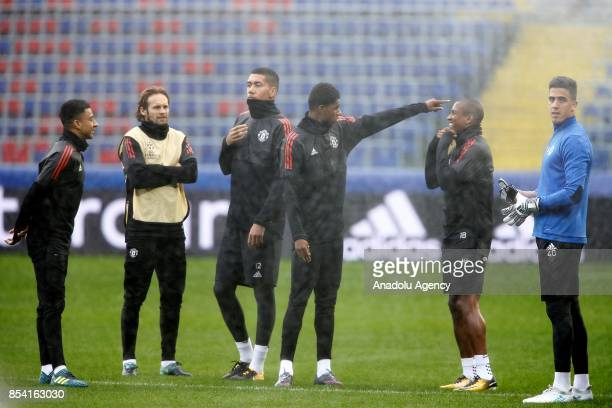 Joel Castro Pereira Chris Smalling and Ashley Young of Manchester United attend a training session of their team ahead of UEFA Champions League Group...