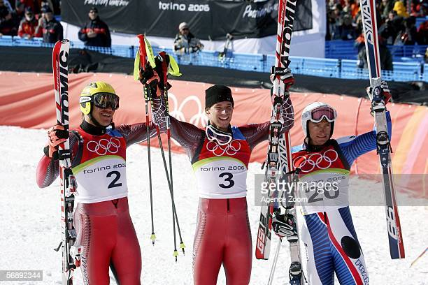 Joel Chenal of France Benjamin Raich of Austria and Hermann Maier of Germany celebrate at the Flower Ceremony after the Mens Alpine Skiing Giant...