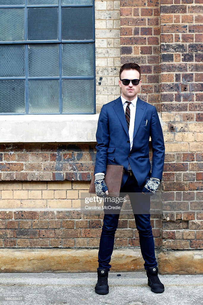Joel Christie wears a jacket by Herringbone, shirt by YSL, jeans by Lee, and shoes by Gucci at Mercedes-Benz Fashion Week Australia Spring/Summer 2013/14 at Carriageworks on April 8, 2013 in Sydney, Australia.