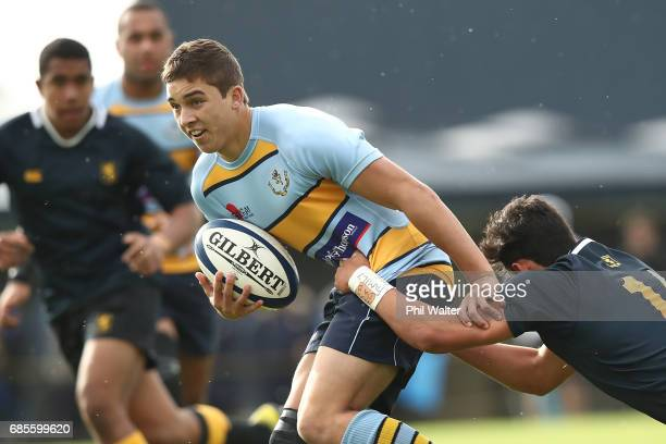 Joel Cobb of Mt Albert Grammar is tackled during the schoolboy First XV rugby match between Mt Albert Grammar and Auckland Grammar at Mt Albert...