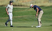 Joel Dahmen walks in to get a look at the line of Richy Werenski's birdie putt attempt on the 15th hole during the second round of the Utah...