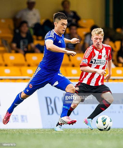 Joel Dixon of Sunderland and Victor Chou Hsieh of South China fight for the ball on day three of the Hong Kong International Soccer Sevens at Hong...