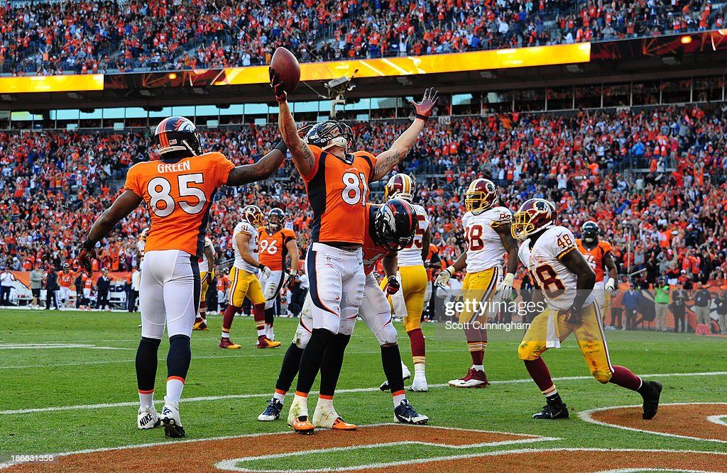 Joel Dreessen #81 of the Denver Broncos celebrates after making a catch for a touchdown against the Washington Redskins at Sports Authority Field on October 27, 2013 in Denver, Colorado.