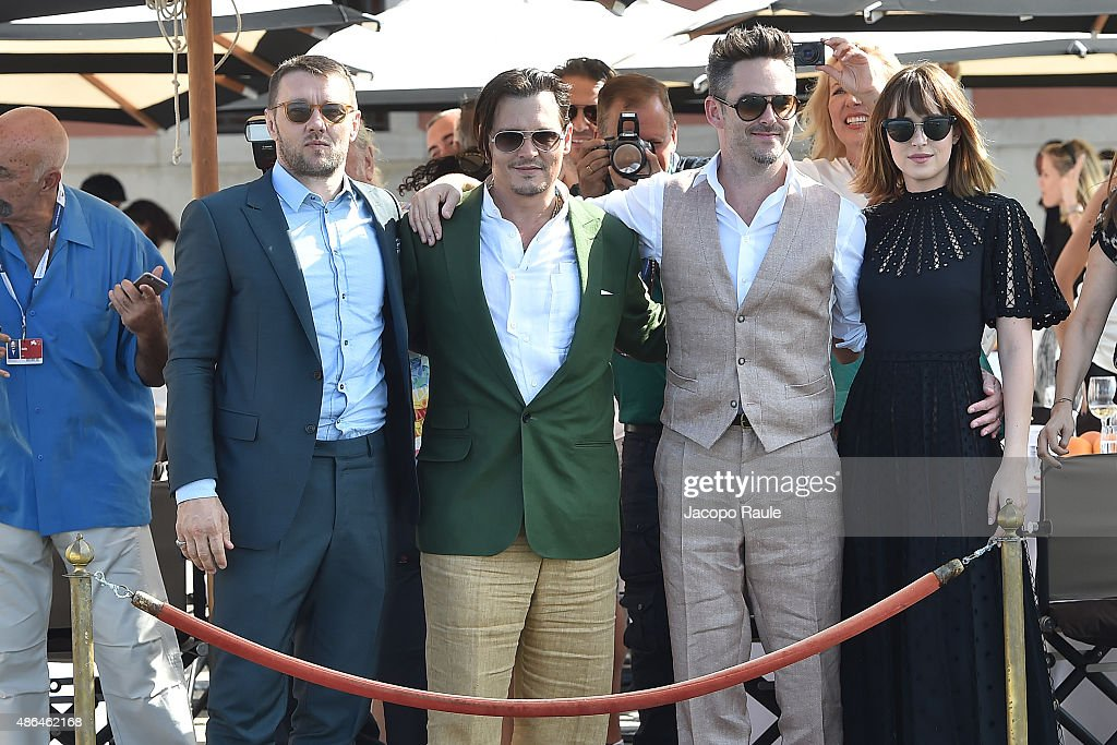 Joel Edgerton Johnny Depp Scott Cooper Dakota Johnson are seen at St Regis Venice San Clemente Palace during the 72nd Venice Film Festival on...