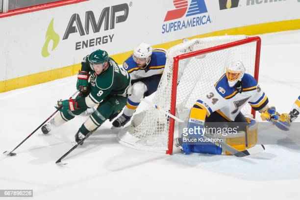 Joel Edmundson and goalie Jake Allen of the St Louis Blues defend against Mikko Koivu of the Minnesota Wild in Game One of the Western Conference...