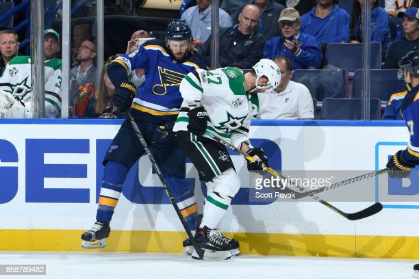 Joel Edmundson of the St Louis Blues and Alexander Radulov of the Dallas Stars battle for the puck on October 7 2017 at Scottrade Center in St Louis...