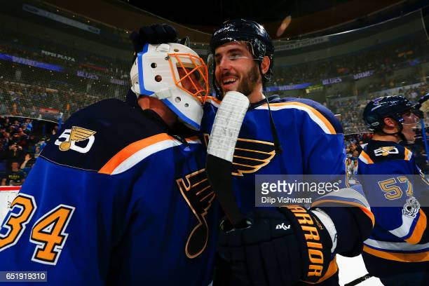 Joel Edmundson of the St Louis Blues and Jake Allen of the St Louis Blues celebrate after beating the Anaheim Ducks at the Scottrade Center on March...
