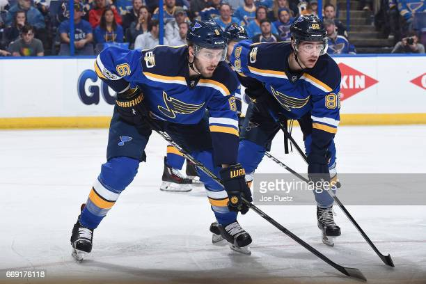 Joel Edmundson of the St Louis Blues and Zach Sanford of the St Louis Blues look on during a game against the Minnesota Wild in Game Three of the...