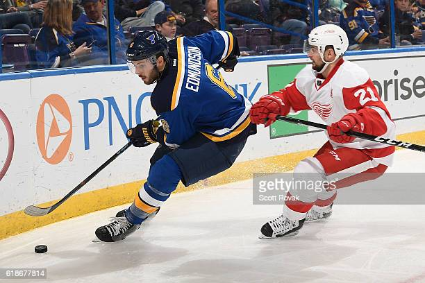 Joel Edmundson of the St Louis Blues beats Tomas Tatar of the Detroit Red Wings to the puck in the third period on October 27 2016 at Scottrade...