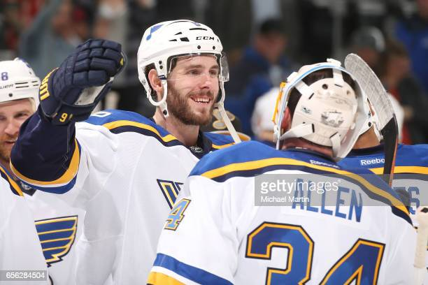 Joel Edmundson of the St Louis Blues celebrates with teammate goaltender Jake Allen after a win against the Colorado Avalanche at the Pepsi Center on...