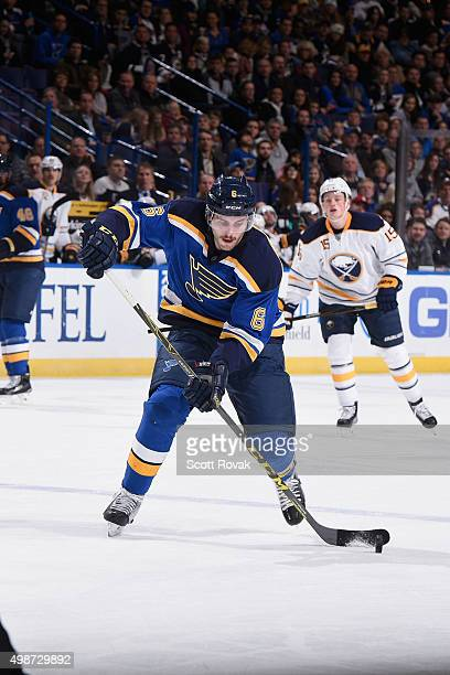 Joel Edmundson of the St Louis Blues controls the puck against the Buffalo Sabres on November 19 2015 at Scottrade Center in St Louis Missouri