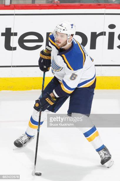 Joel Edmundson of the St Louis Blues handles the puck against the Minnesota Wild during the game on March 7 2017 at the Xcel Energy Center in St Paul...