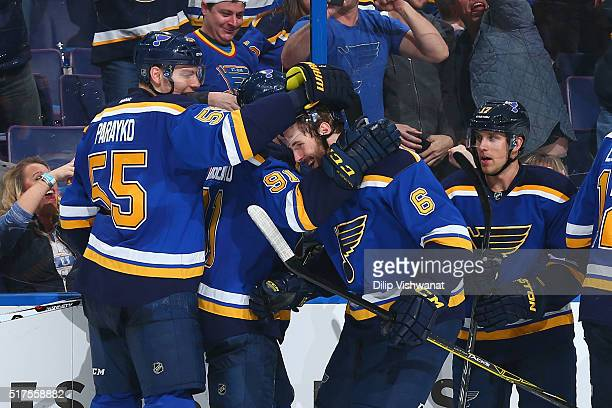 Joel Edmundson of the St Louis Blues is congratulated by teammates after scoring his first NHL goal against the Vancouver Canucks at the Scottrade...