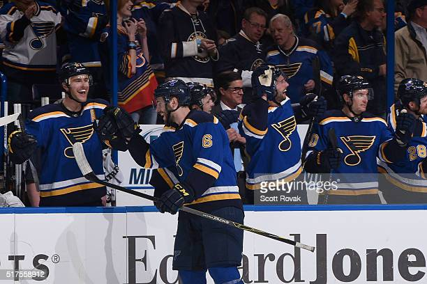 Joel Edmundson of the St Louis Blues is congratulated by teammates after scoring his first career goal while playing against the Vancouver Canucks at...