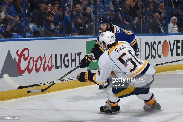 Joel Edmundson of the St Louis Blues makes a pass against Kevin Fiala of the Nashville Predators in Game One of the Western Conference Second Round...