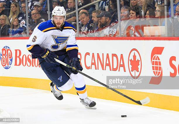 Joel Edmundson of the St Louis Blues plays the puck during first period action against the Winnipeg Jets at the MTS Centre on October 18 2015 in...