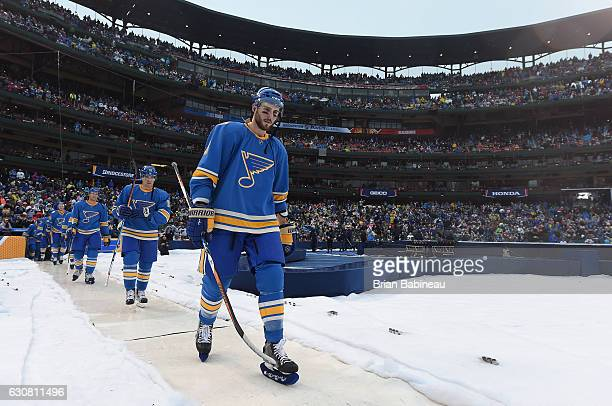 Joel Edmundson of the St Louis Blues walks to the rink prior to playing the 2017 Bridgestone NHL Winter Classic at Busch Stadium against the Chicago...