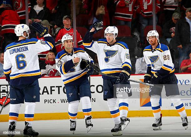 Joel EdmundsonScott GomezMagnus Paajarvi and Martin Havlat of the St Louis Blues celebrate the win over the New Jersey Devils on November 10 2015 at...