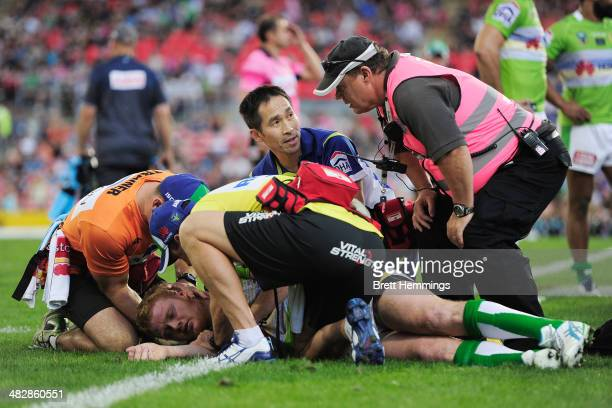 Joel Edwards of the Raiders receives treatment from trainers after a heavy hit during the round five NRL match between the Penrith Panthers and...