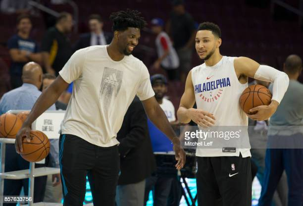 Joel Embiid and Ben Simmons of the Philadelphia 76ers warm up prior to the preseason game against the Memphis Grizzlies at the Wells Fargo Center on...